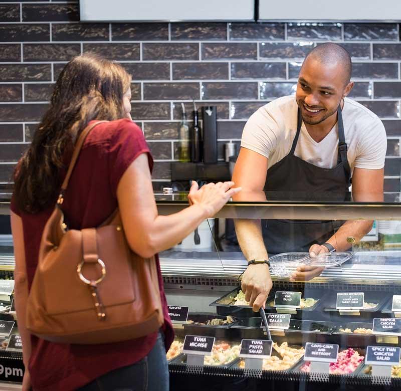 Man serving woman food